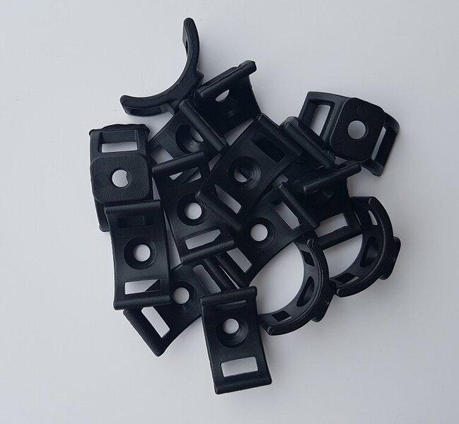 Plastikiniai diržų tvirtinimo elementai (juodi) 100g.